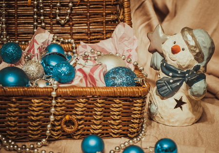 sackful: Christmas decoration with balloons in the box on warm background with pretty snowman Stock Photo