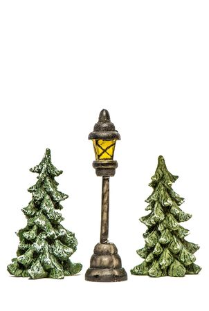 Christmas trees with lantern on white background isolated