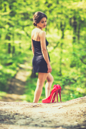 without legs: Barefoot brunette girl outdoor with red high heels