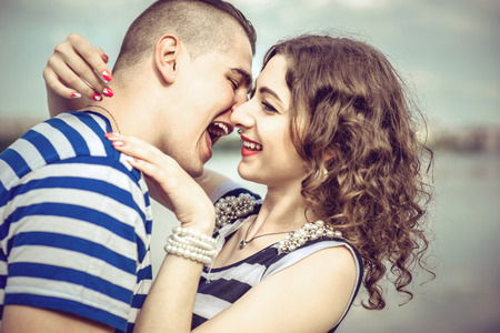 romance sky: Lovely couple outdoor with lake on background Stock Photo