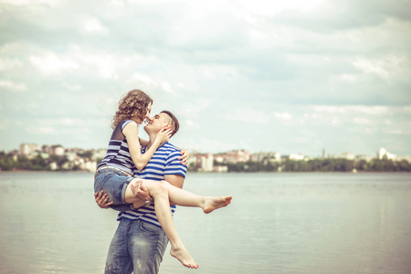 lovely couple: Lovely couple outdoor with lake on background Stock Photo