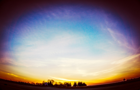 ojo de pez: Evening sunset on the field with colorful sky, fish eye effect