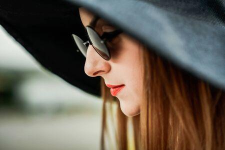 nude female body model: Portrait of pretty girl in black hat outdoor