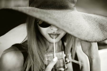 hat nude: Portrait of young pretty girl drinking cold beverage Stock Photo