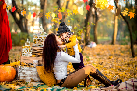 Happy mother with her little son playing in the park Stock Photo