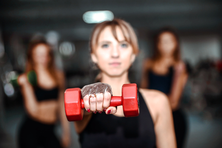 gym workout: Three pretty girls workout in the gym Stock Photo