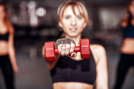 hard working people: Three pretty girls workout in the gym Stock Photo