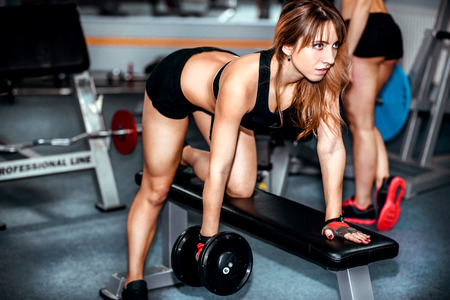 workout gym: Two pretty girls workout in the gym Stock Photo