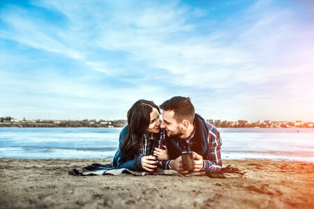 have fun: Pretty young couple have fun on the beach Stock Photo