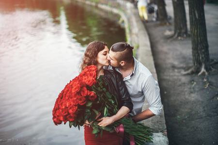Pretty couple  in the park near lake