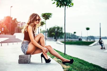 Pretty girl in high heels in the park