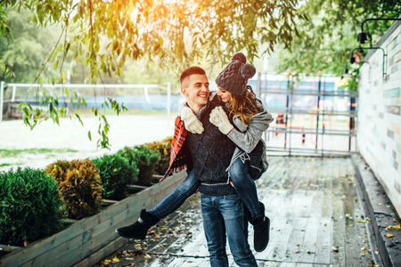 Young happy couple have fun in the park