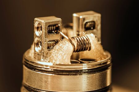 Closeup shot of dripping atomiser with coils