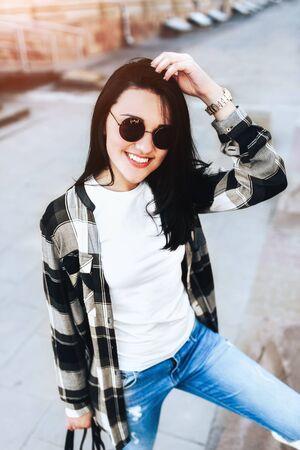 Pretty brunette girl relaxing on the city street