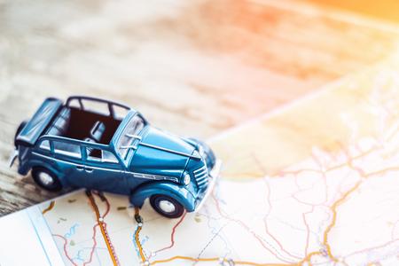 retro cabrio car on the map, tourism concept