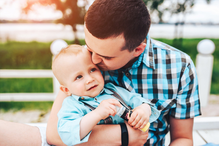Young father with his little son have fun outdoor in the park