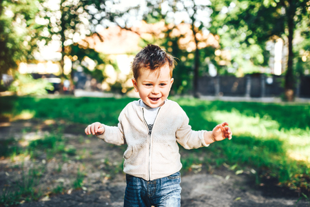 Cute liitle boy playing outdoor in the park
