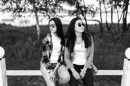 Two Pretty Girls Talking Outdoor In The Park Black And White Stock Photo
