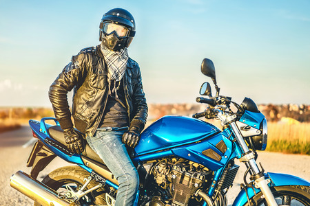 Biker on sport motorcycle outdoor on the road
