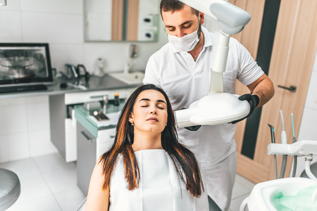 Dentist making x-ray for the female patient in the clinic Stock Photo