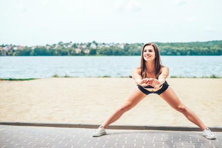 Pretty young brunette sporty girl workout outdoor Stock Photo