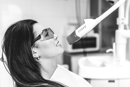 Teeth whitening in dental clinic for female patient