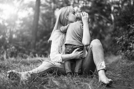 Happy mother with her little daughter playing outdoor