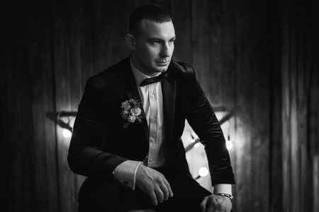 Portrait of groom with wooden background Stock Photo