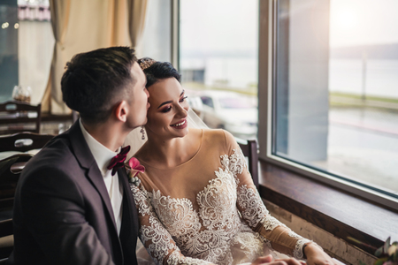 Pretty wedding cuople relaxing in resturant Stock Photo