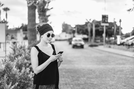 Pretty tourist girl speaks by phone outdoor