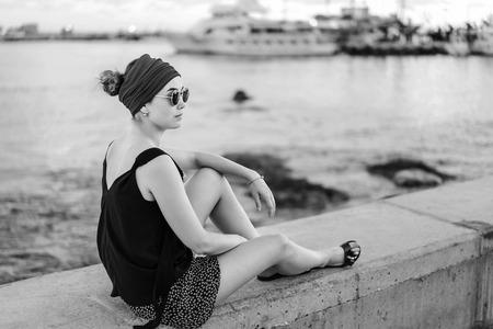 Pretty brunette tourist girl relaxing near sea