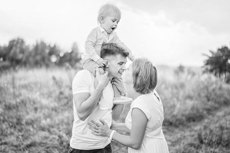 Young pretty family with little son have fun outdoor Banque d'images