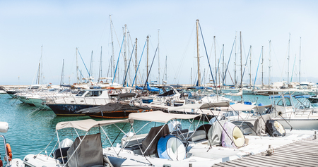 Sailboat harbor with many beautiful sail yachts in the sea port, water transport
