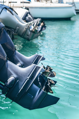 Closeup photo of yacht engine in  sailboat harbor in the sea port Stock Photo