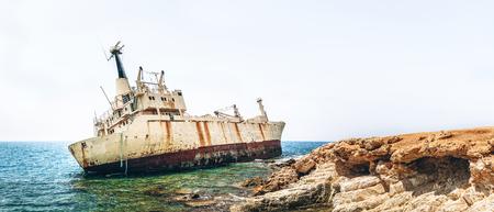 Old damaged rusty transportation ship after crash  on the coastline Reklamní fotografie