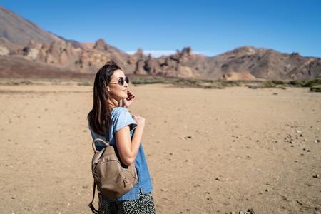 Pretty brunette girl walking outdoor near teide volcano on tenerife island Фото со стока