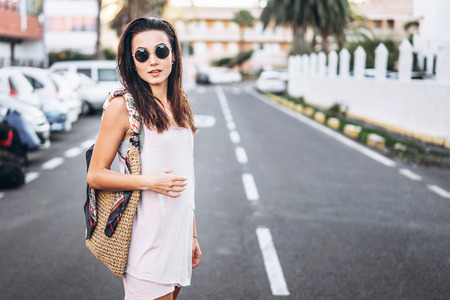 Pretty long hair brunette girl walking on the street