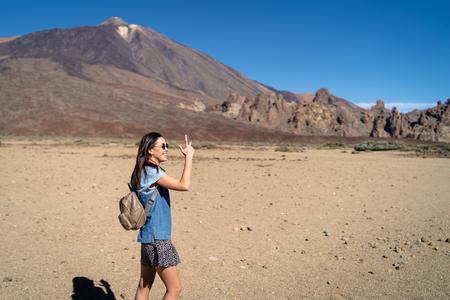 Pretty brunette girl walking outdoor near teide volcano on tenerife island 스톡 콘텐츠