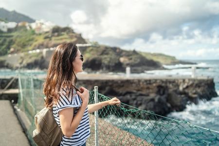 Pretty brunette girl walking outdoor near sea