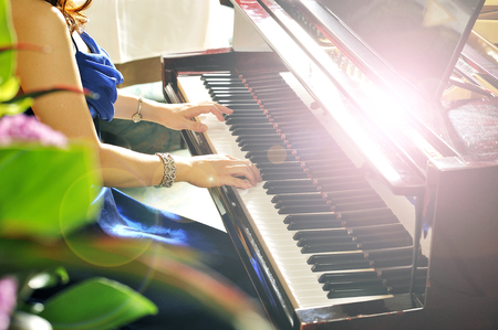 piano player: Women playing the grand piano in the room Stock Photo