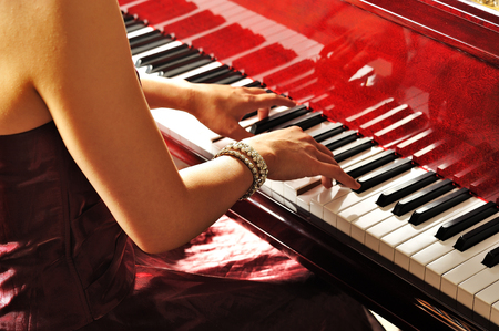 Women playing the grand piano in the room Stock Photo