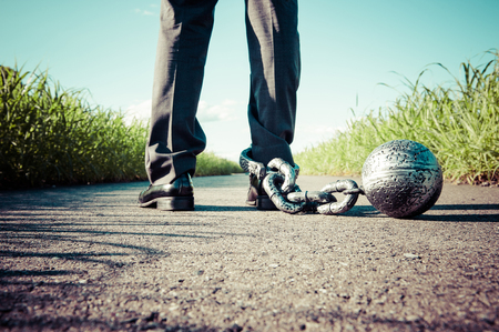 chain: Businessman attached the shackles