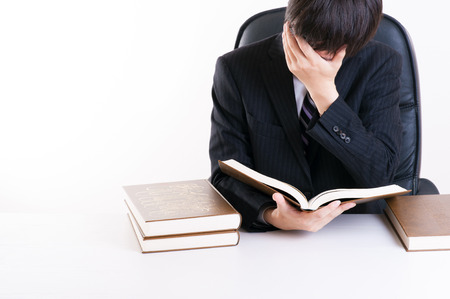 difficult to find: Reading book Stock Photo