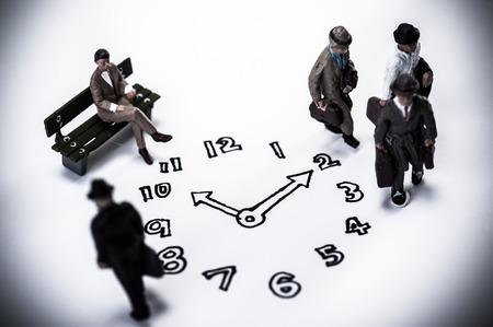 clock and businessmen