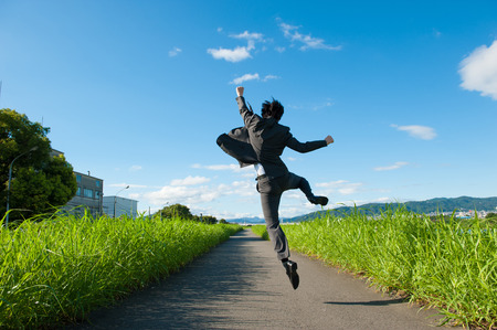 achieve goal: From behind the businessman to jump