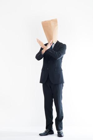 reproach: Young businessman wearing a carton Stock Photo