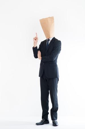 cowardice: Young businessman wearing a carton Stock Photo
