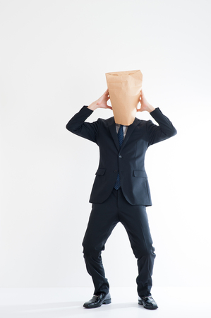 multiple personality: Young businessman wearing a carton Stock Photo