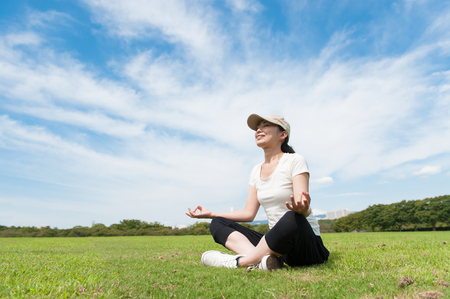 sanskrit: Women who have a pose of yoga on the lawn