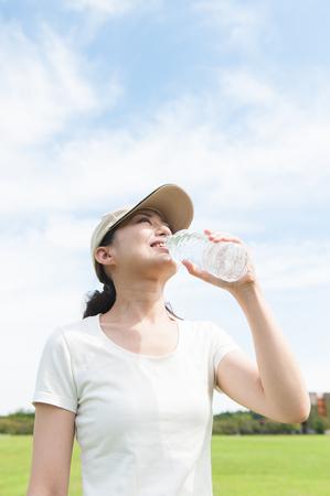 bottled water: Women are drinking bottled water